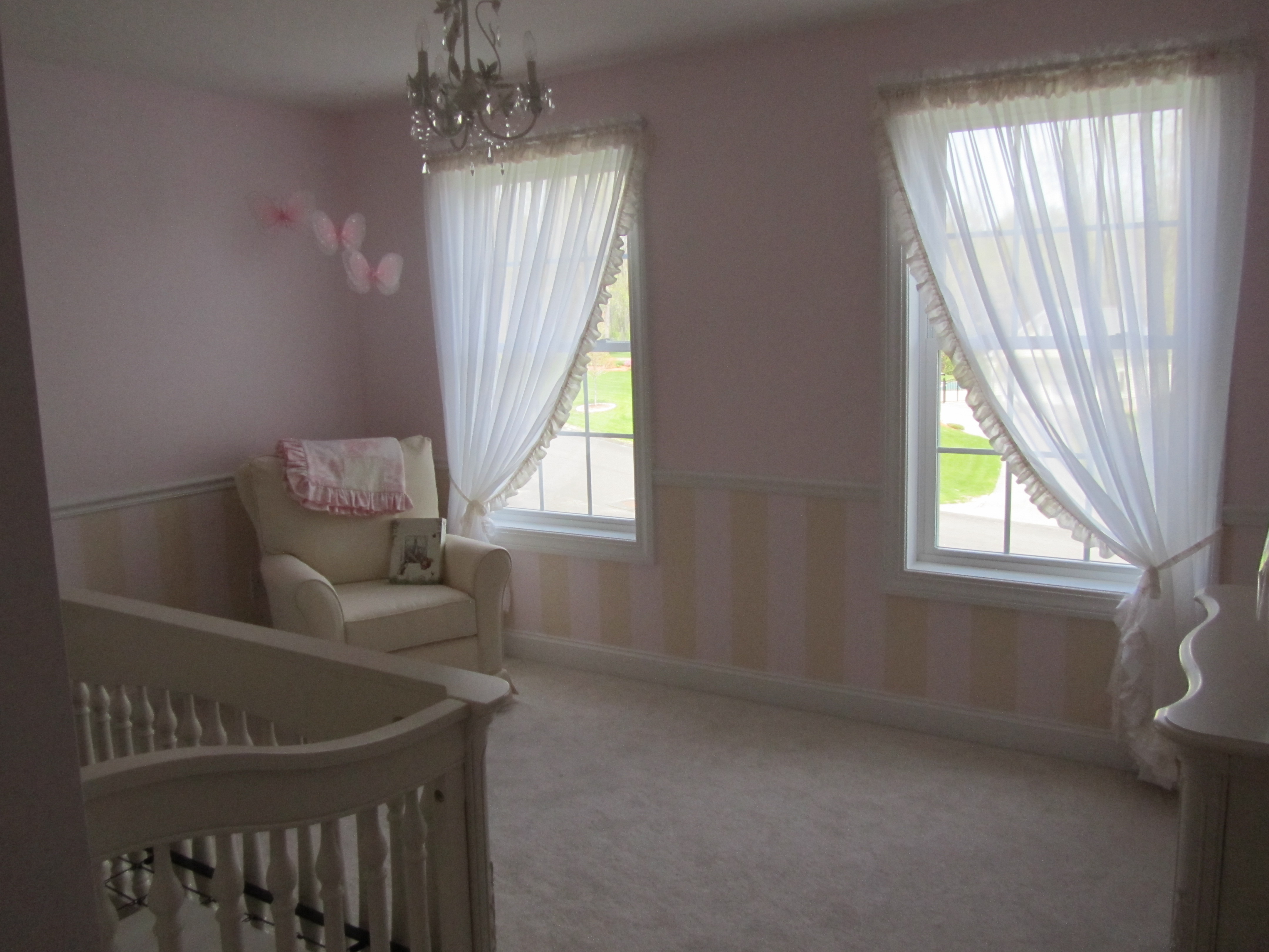 Chair Rail Nursery Part - 39: The Walls Are Soft Pale Pink With Stripes Of Off White Paint Separated By  White Chair Rail. My Husband Did All Of This Himself And It Came Out  Fantastic.